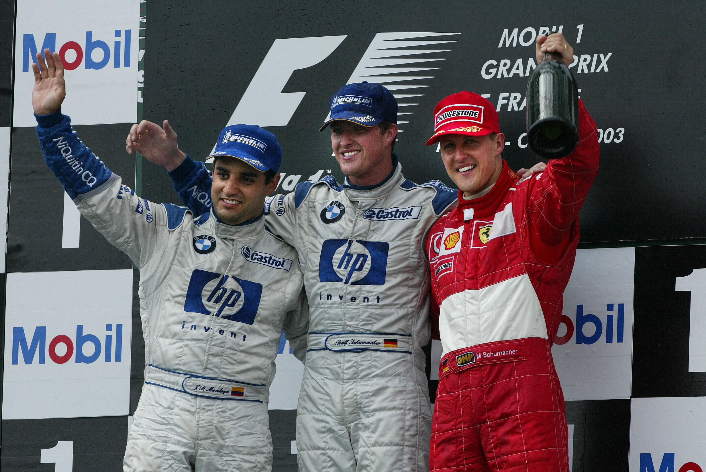 I 2003 fikk Michael til dels hard konkurranse fra Williams-førerne, som her deler podiet med tyskeren etter Frankrike GP. Til venstre Juan-Pablo Montoya, mens vinneren er Michaels yngre bror Ralf Schumacher. Foto: Williams
