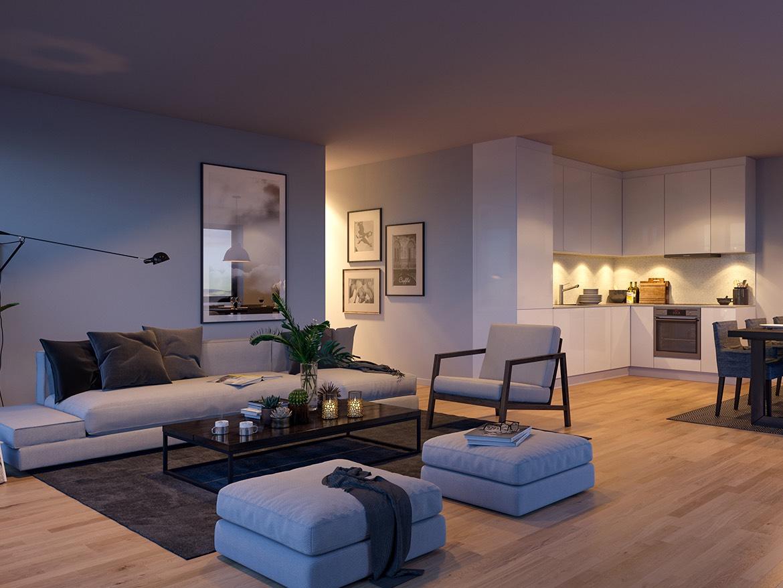 Den åpne løsningen mellom stue og kjøkken skaper et romslig oppholdsrom i D4.4