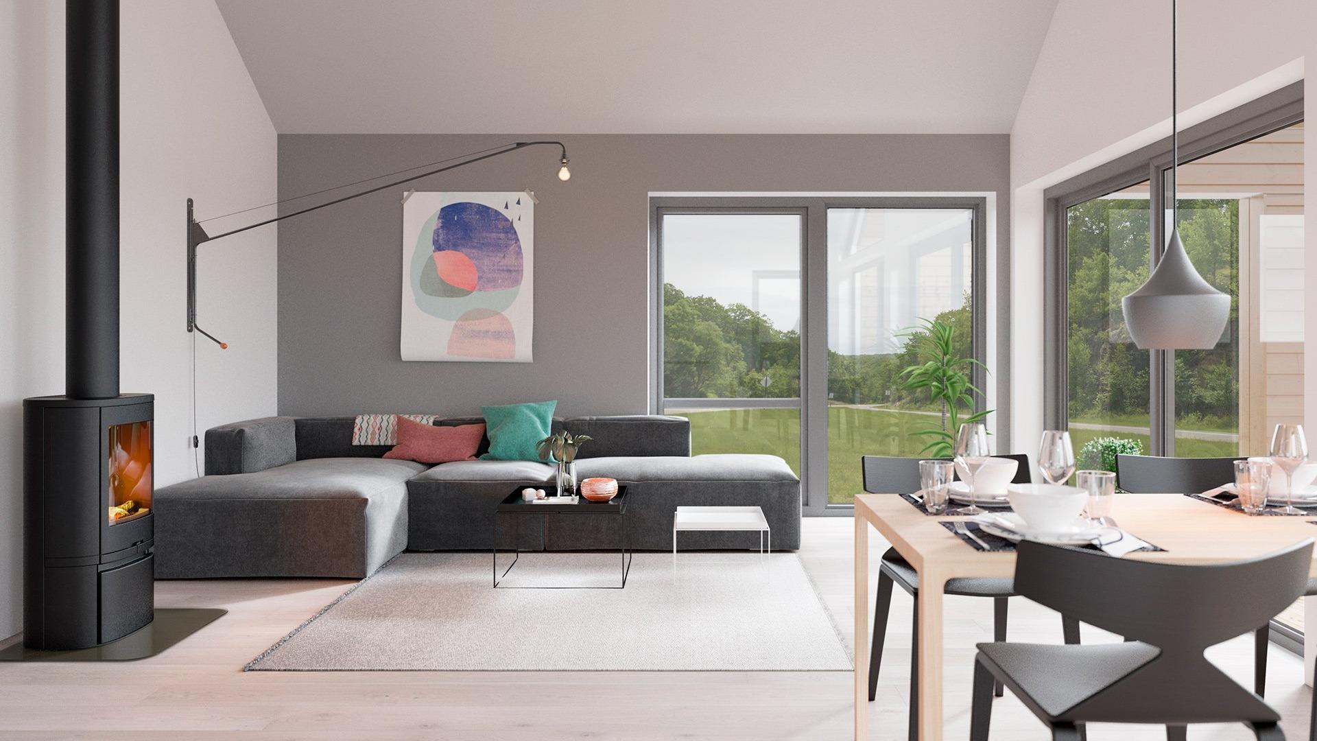 Her er det høyt under taket, og de store vindusflatene inviterer dagslyset inn og gjør stue og kjøkken til luftige rom