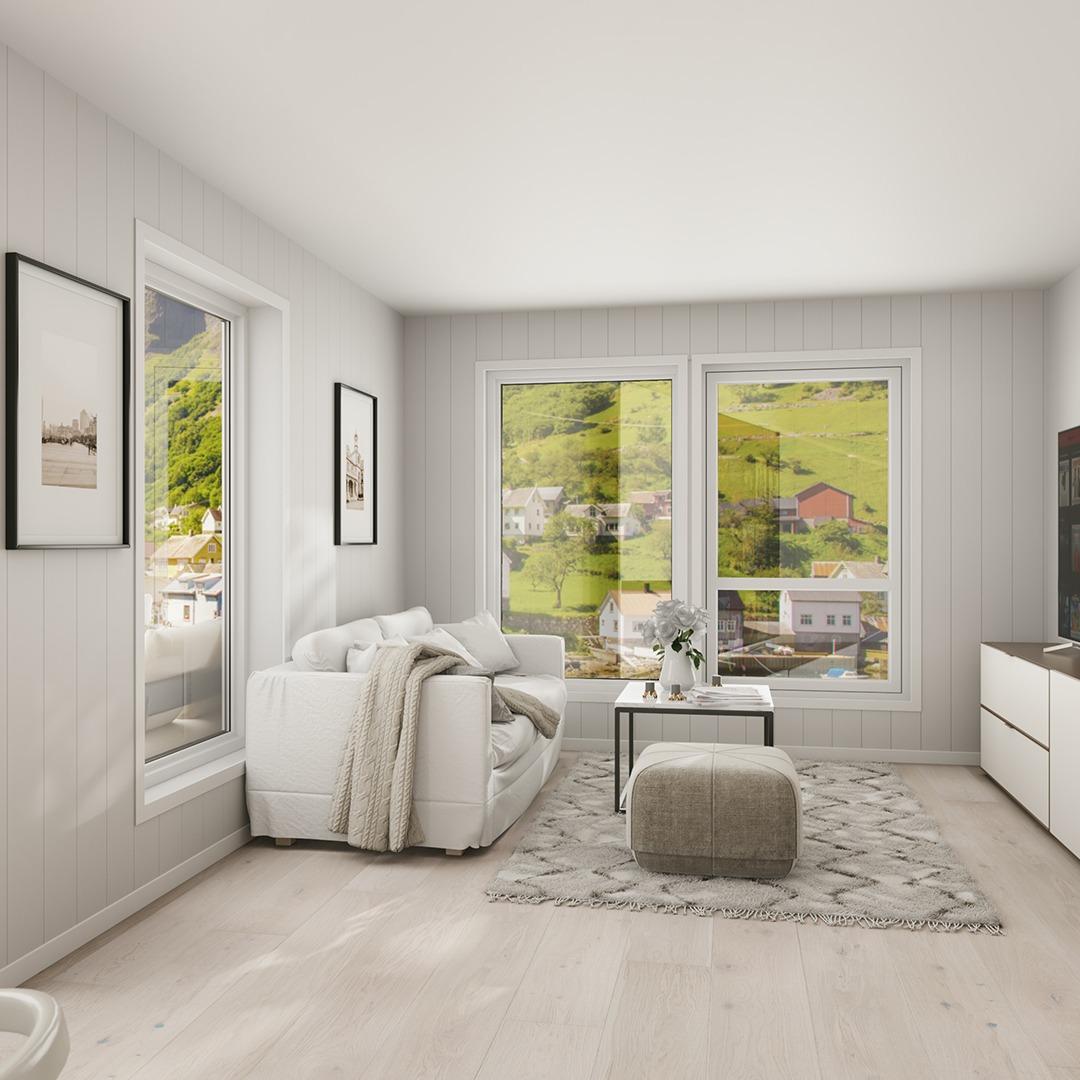 Store vindusflater og verandadør gir en god romfølelse.