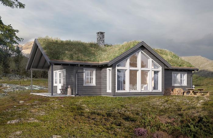 Stor og romslig stue som stikker ut fra hytta for mer lys og utsikt